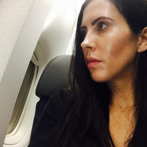 Leesa on a plane on her way to Madrid.
