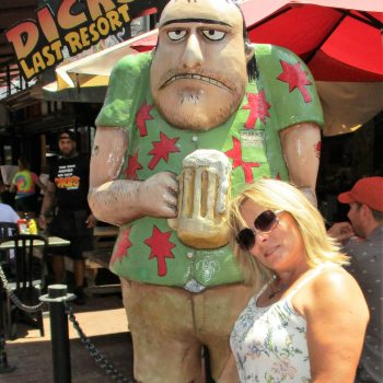 A photo of Ed's wife posing next to a cartoonish statue in Quincy Market, one of the best things to do in Boston.