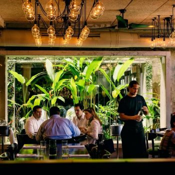 A photo of a waiter and customer at Santaella, one of the best places to eat in San Juan