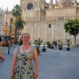 Kristen in front of the Seville Cathedral