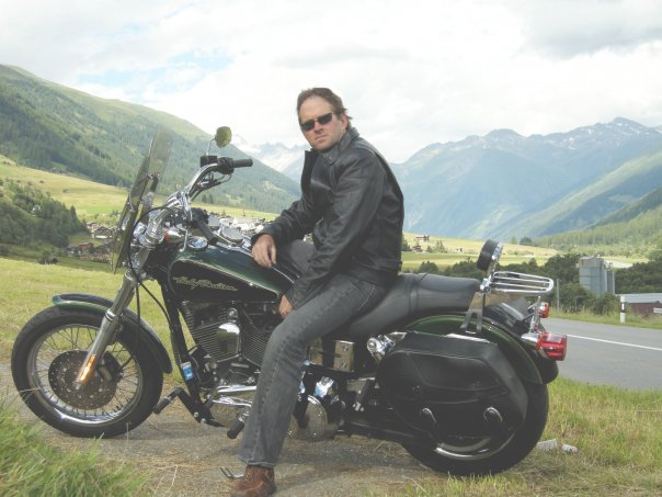 Adam Rogers on a motorcycle in Switzerland before he was able to start taking action online