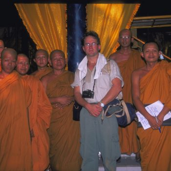 Adam Rogers surrounded by monks before he was able to start taking action online