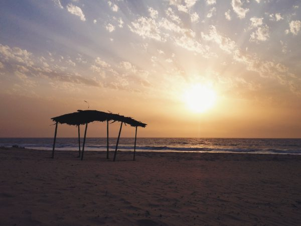 The sun setting on the beach at the Gambia.