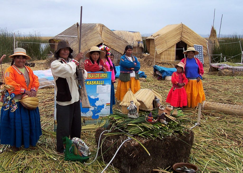 Some Uros Villagers on Lake Titicaca, one of the best things to do in Peru.