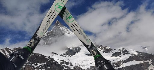 A creative view of the Matterhorn, which is framed by two skis.