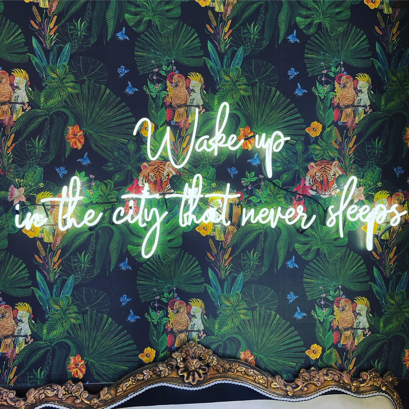 "Wallpaper with LED lights that say ""Wake up in the city that never sleeps"""