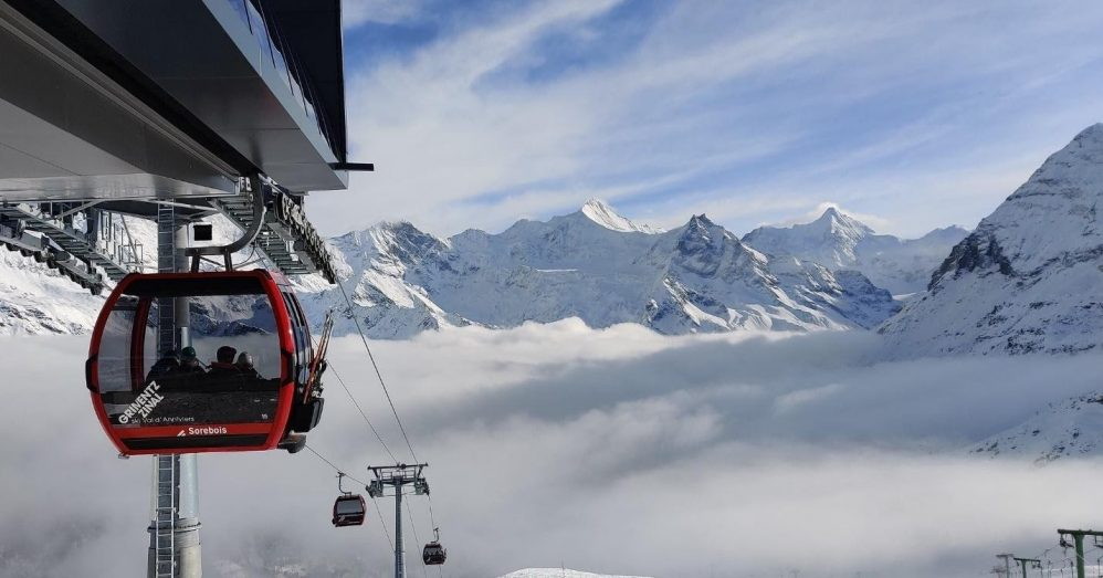 Zinal's ski lifts overlooking the clouds below the mountain peaks.