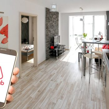 A photo of an AirBnb apartment and the app.
