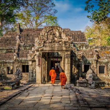 Monks walking into Angkor Wat