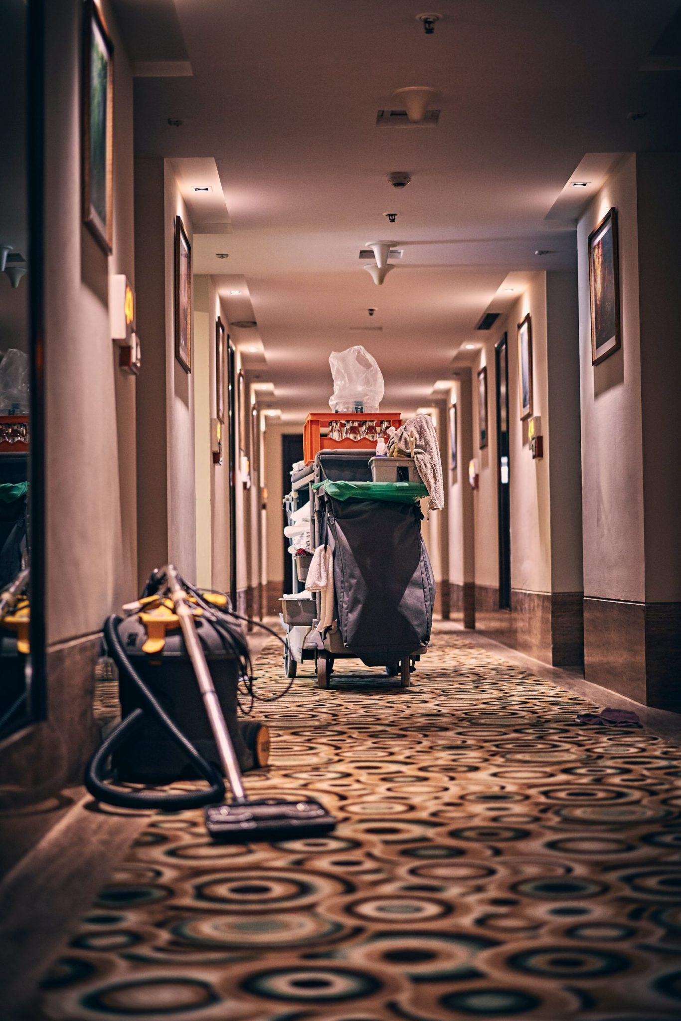 A hotel cleaner's cart, front line workers helping people to quarantine after flying