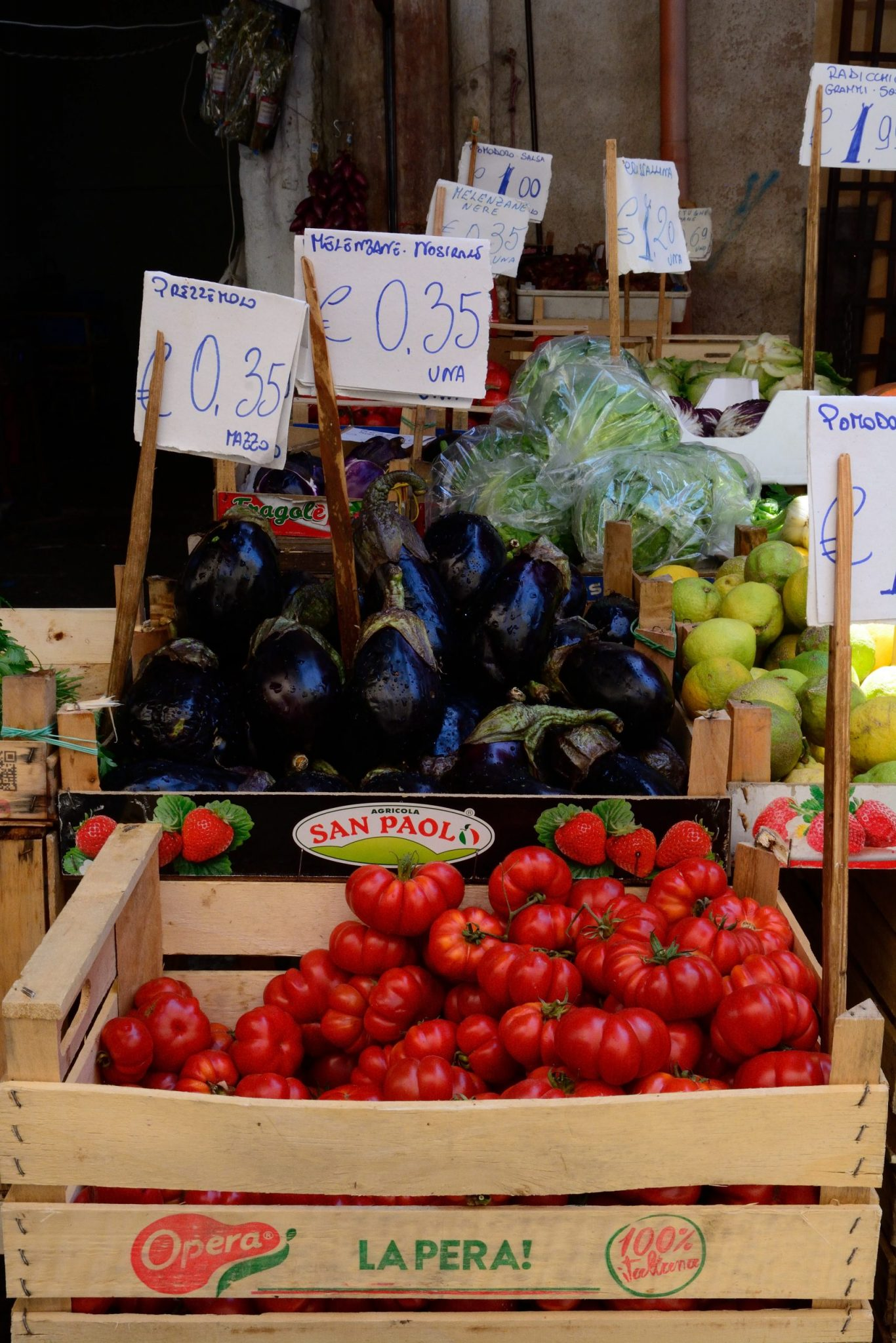 a photo of eggplants and tomatoes for sale in Italy