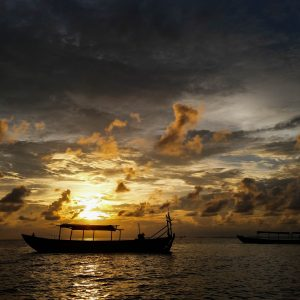 A boat in front of the sunset in Cambodia.