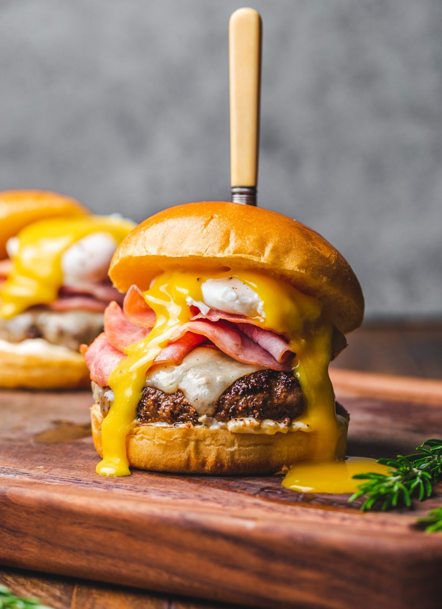 An eggs benedict burger, similar to what you can find in Au Cheval, Chicago.