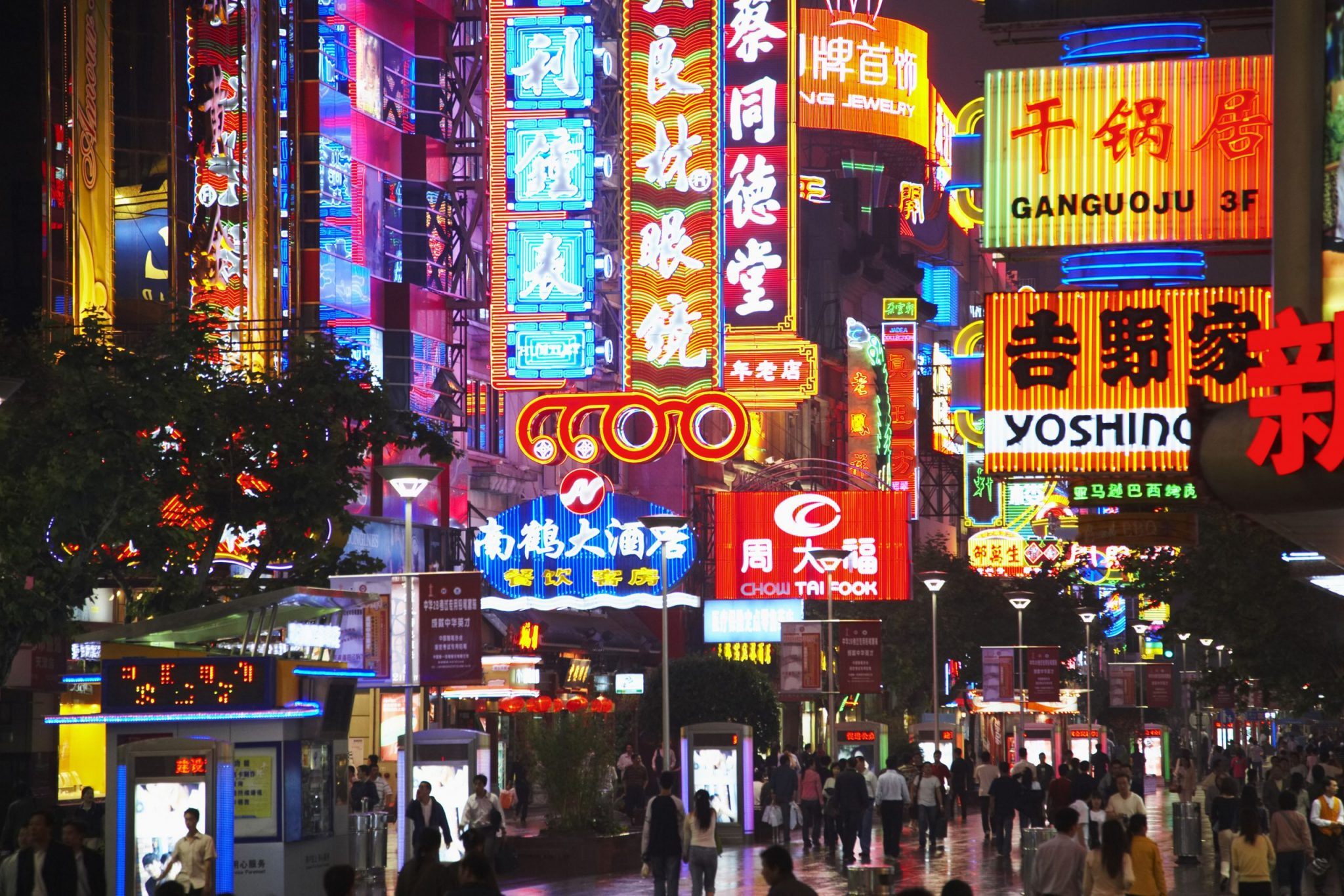 City street lit up at night, Shanghai, China. A potential nighttime view while on an adventure to teach English abroad