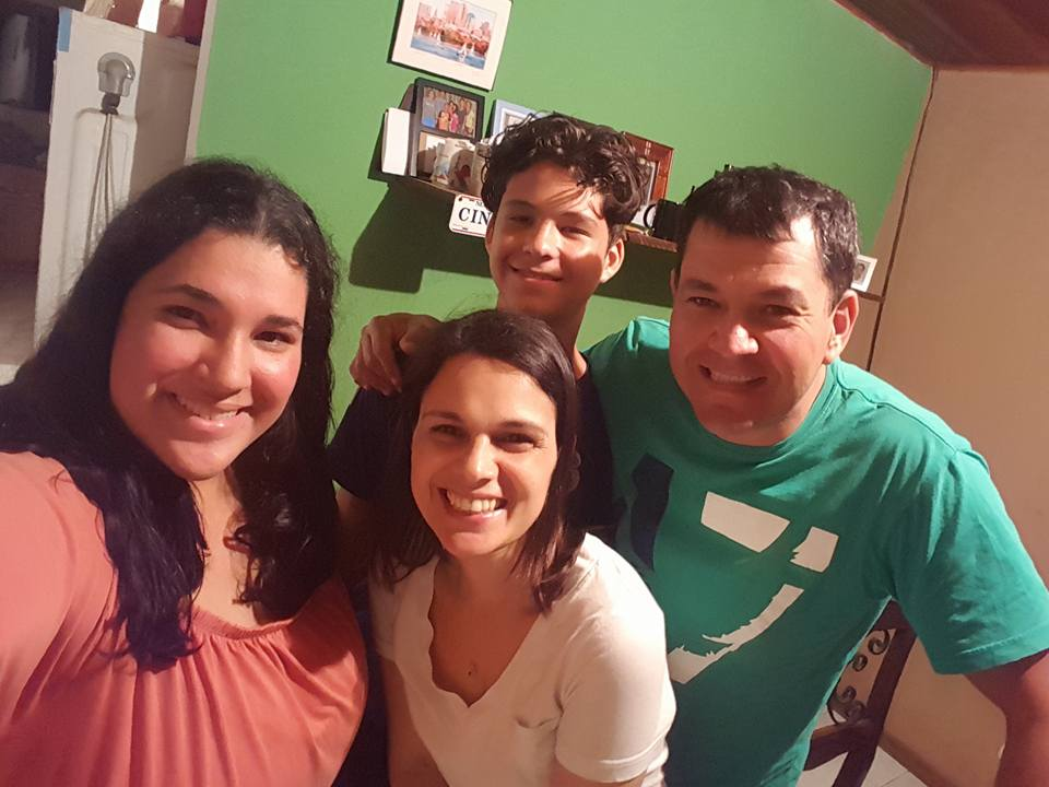 Alexandra with her host family while volunteering in Costa Rica