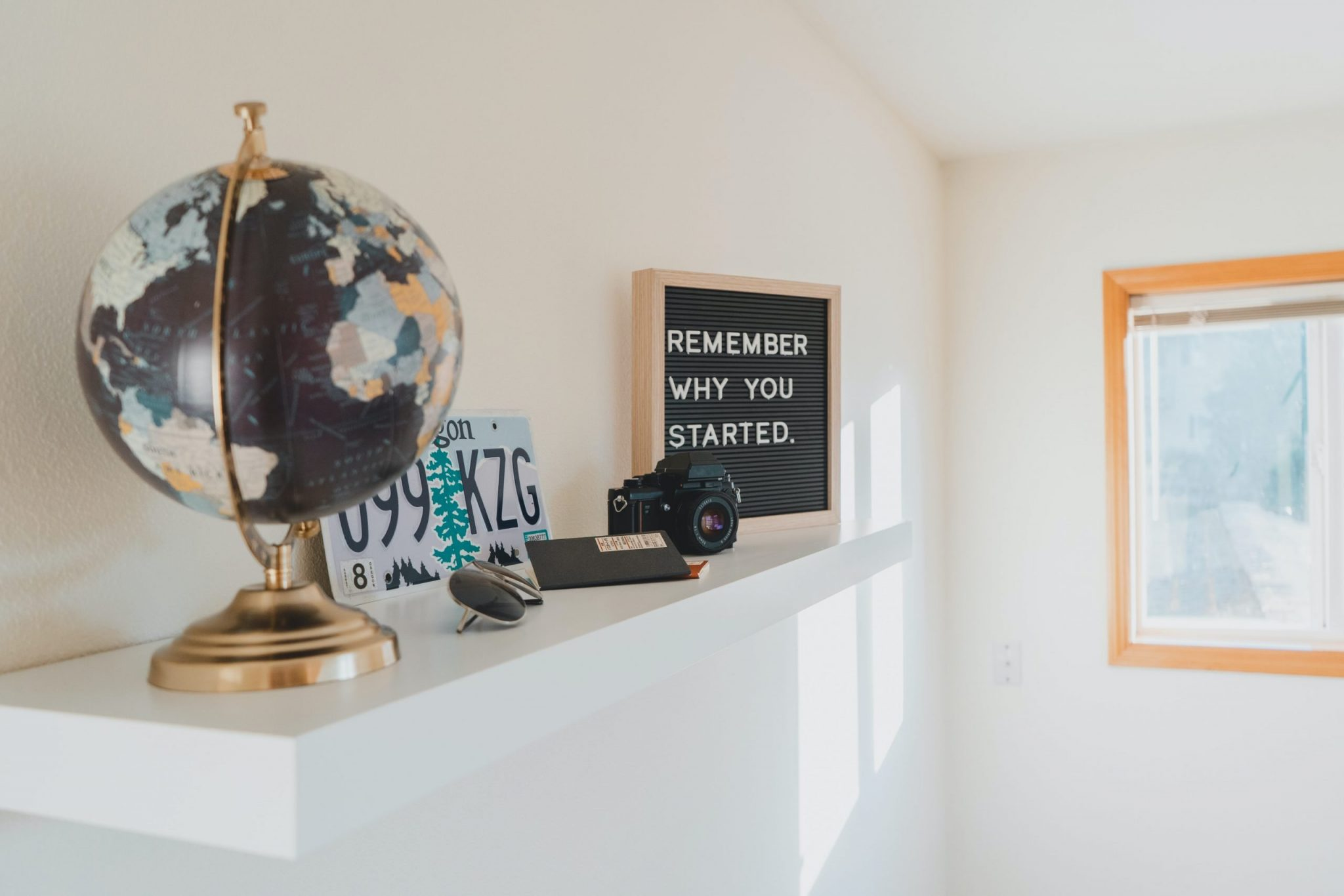 A picture of a mantle with travel related items