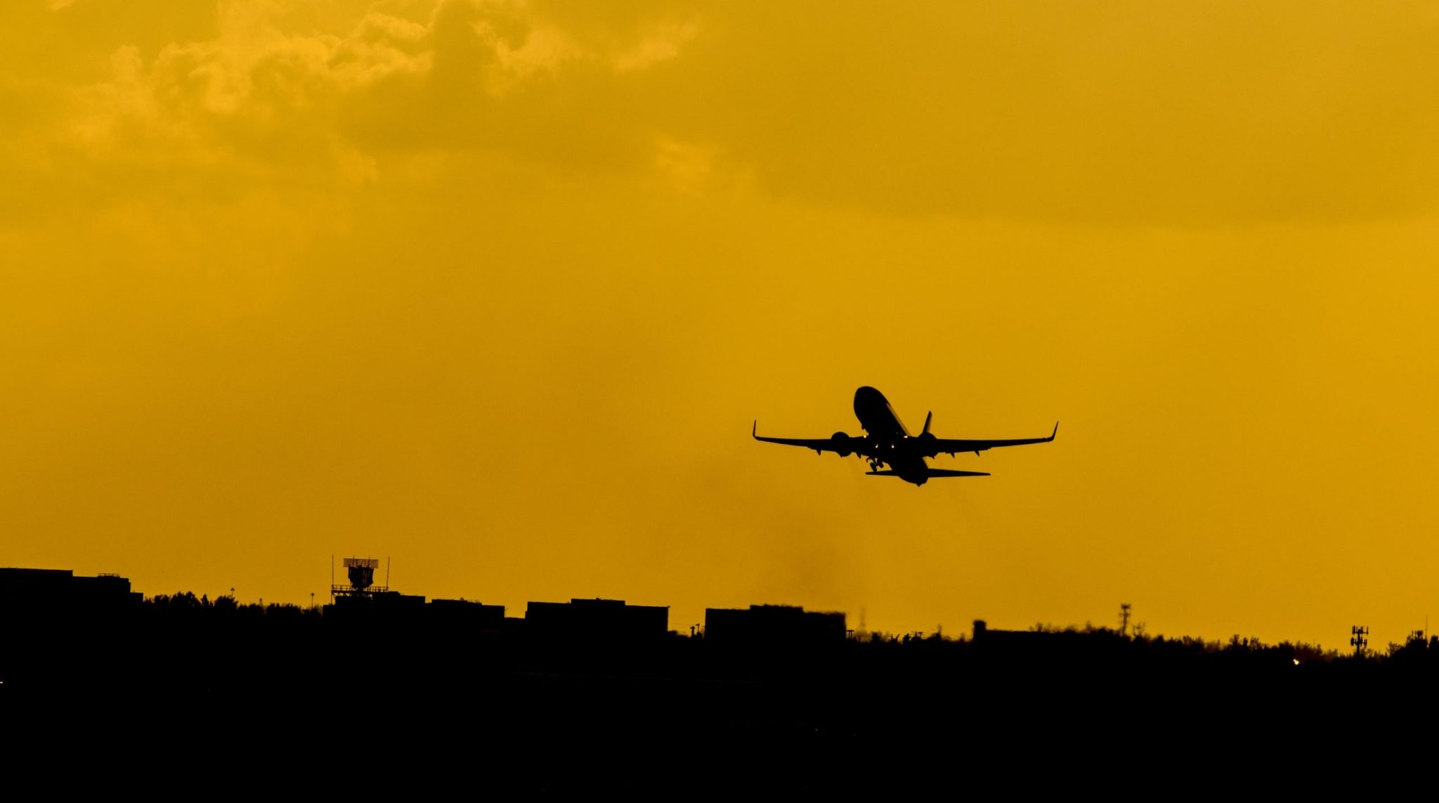 A plane taking off into the sunset. Take the leap to teach English in Thailand.