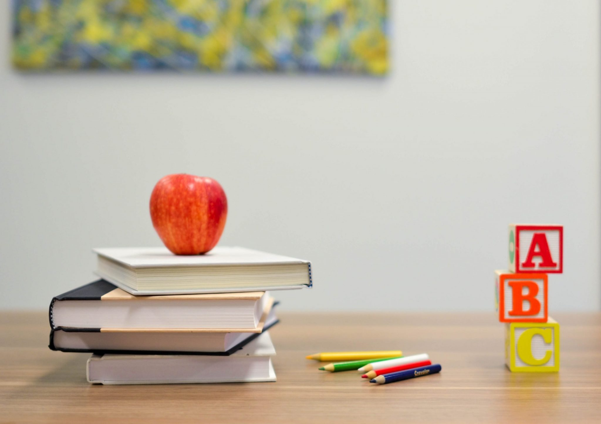 Picture of school books and an apple