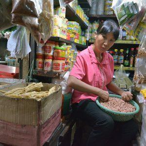 A shopkeeper in Cambodia.
