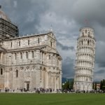 The Leaning Tower of Pisa in front of a stormy backdrop