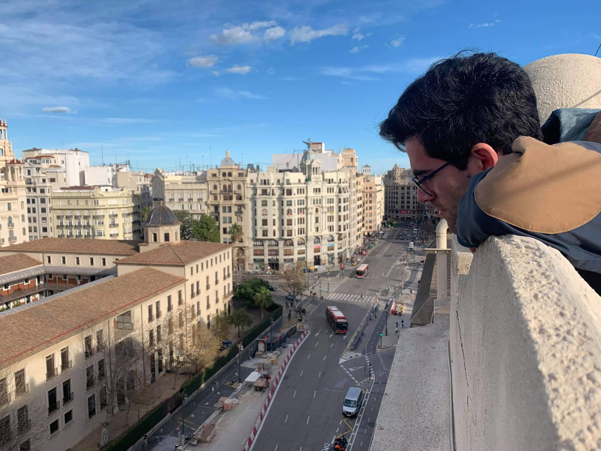 Kevin Mascitelli looking down at the street from the roof.