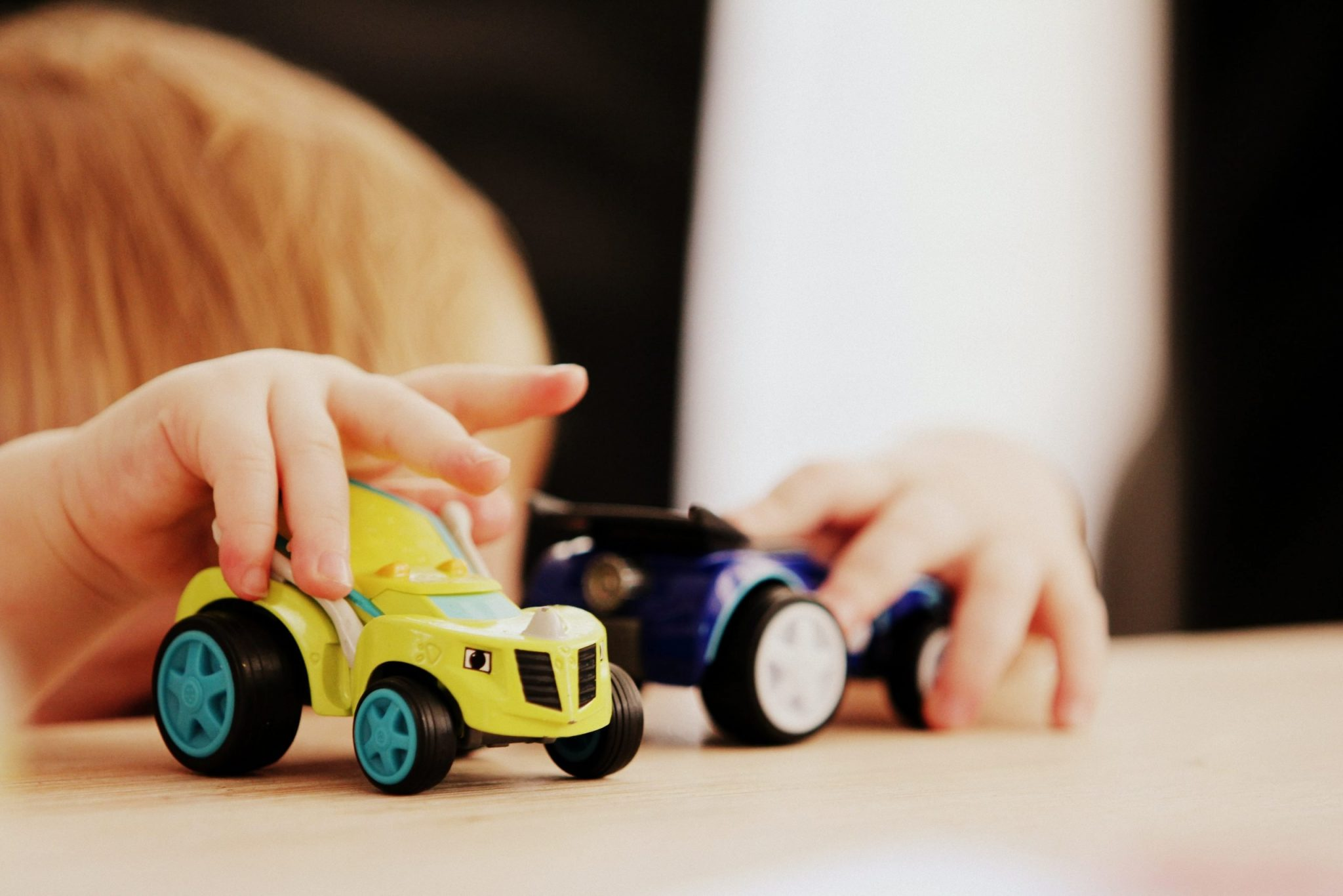 reflections of teaching photo of child playing with cars
