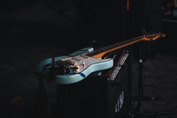Blue electric guitar in a dark room