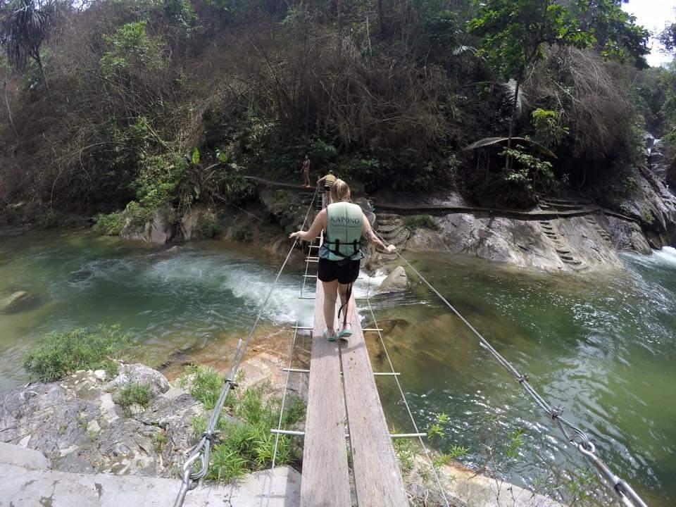 thai culture walking on a bridge